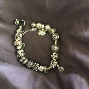 Pandora has 15 charms 4 clips w/ safety chain